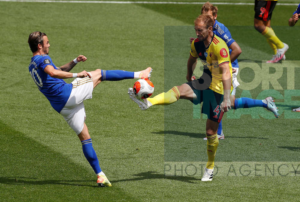 James Maddison of Leicester City challenges Craig Dawson of Watford during the Premier League match at Vicarage Road, Watford. Picture date: 20th June 2020. Picture credit should read: Darren Staples/Sportimage