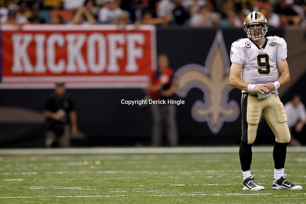 September 9, 2010; New Orleans, LA, USA;  New Orleans Saints quarterback Drew Brees (9) stands on the field during the NFL Kickoff season opener at the Louisiana Superdome. The New Orleans Saints defeated the Minnesota Vikings 14-9.  Mandatory Credit: Derick E. Hingle
