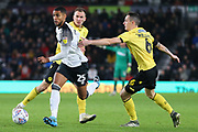 Derby County defender Max Lowe (25) goes past Millwall midfielder Shaun Williams (6) during the EFL Sky Bet Championship match between Derby County and Millwall at the Pride Park, Derby, England on 14 December 2019.
