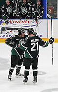 Roughriders' John Gilmour (3) celebrates with Greg Amlong (21) after scoring a goal during their game at the Cedar Rapids Ice Arena, 1100 Rockford Road SW in Cedar Rapids on Saturday evening, February 18, 2012. (Stephen Mally/Freelance)