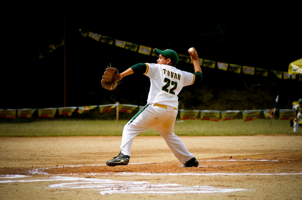 A little league pitcher plays during the 2009 championship at the same field where Mets' pitcher Johan Santana grew up playing baseball. Santana went back to Tovar, Venezuela last weekend for an annual charity event thrown by the Johan Santana Foundation and passed out 10,000 toys to local children. Before throwing the opening pitch of the little league championship, Santana also surprised every team in the league with new equipment.