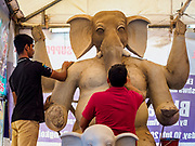 06 SEPTEMBER 2018 - BANGKOK, THAILAND: Workers touch up the clay on statues of Ganesh at Wat Witsanu Hindu Temple in Bangkok. Indian craftsmen are making statues of the Hindu deity Ganesha for the Ganesh Chaturthi, or Ganesh Festival, held at Hindu temples in September. All of the craftsmen, and the clay they use to fashion the statues, come from India every year to make the statues. Although Thais are predominantly Buddhist, the Lord Ganesh, the Hindu overcomer of obstacles, is worshipped by many Thais and Ganesh Chaturthi is celebrated in many Thai communities.    PHOTO BY JACK KURTZ