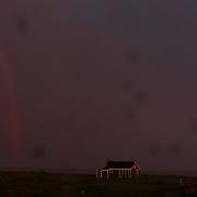 A rainbow during a thunder and lightening storm as it hits the coastline at Cisco Beach, Nantucket, Nantucket Harbor on Nantucket Island, Massachusetts, USA. Photo Tim Clayton