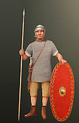 Illustration of a Roman auxiliary soldier from the Hadrian era, 125 AD, by Nick Hardcastle, at the Housesteads Roman Fort Museum, Hadrian's Wall, Northumberland, England. An auxiliary would wear a chainmail coat and iron helmet, with a long sword and spear and oval wooden shield, enclosed boots like those found at Vindolanda, and close-fitting trousers. 10 centuries of auxiliary soldiers were based at Housesteads Fort. Hadrian's Wall was built 73 miles across Britannia, now England, 122-128 AD, under the reign of Emperor Hadrian, ruled 117-138, to mark the Northern extent of the Roman Empire and guard against barbarian attacks from the Picts to the North. The Housesteads Roman Fort Museum is run by English Heritage and forms part of the Hadrian's Wall UNESCO World Heritage Site. Picture by Manuel Cohen