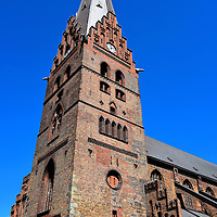 Sankt Petri Church's Bell Tower in Malmö, Sweden<br /> Looming over the narrow streets of Malmö is the 344 foot, gothic brick bell tower of Sankt Petri Kyrka. St. Peter's Church was built in 1319, making it the oldest building in the city. Admission is free. It is worthwhile stepping inside this Church of Sweden and stepping back into Medieval times.