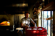 Chef Jay Blackinton preps pizza dough at his restaurant Hogstone Wood Oven in Orcas Island, Washington