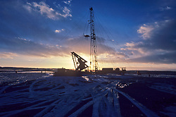 on-shore rig at dusk