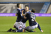 GOAL 1-1 Millwall midfielder Jiri Skalak scores and celebrates with Millwall midfielder Shaun Williams (6) and Millwall defender Ryan Leonard (28) during the EFL Sky Bet Championship match between Millwall and Bolton Wanderers at The Den, London, England on 24 November 2018.