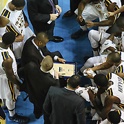 Drexel Head Coach James Flint instructs his team during a time out in the second half of a NCAA regular season Colonial Athletic Association conference game between Delaware and Drexel Sunday, Feb 23, 2014 at The Bob Carpenter Sports Convocation Center in Newark Delaware.