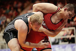 London, Ontario ---2013-03-02---   Kyle Nguyen of The University Of Winnipeg takes on Samson Swan of The University Of Saskatchewan in the men's 130 KG bronze medal match at the 2012 CIS Wrestling Championships in London, Ontario, March 02, 2013. .GEOFF ROBINS/Mundo Sport Images