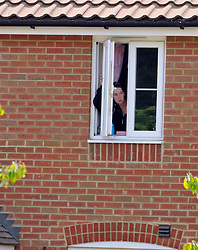 © licensed to London News Pictures. Norwich, UK  06/05/2011. A woman talks to police officers from an upstairs window of the property. Police at a house in Norwich today (06 May 2011). A man is believed to be holding a woman hostage inside the residence. The woman briefly appeared at a window of the property and spoke to police officers. A number of armed police officers and a police helicopter are at the scene. Please see special instructions for usage rates. Photo credit should read Alan Bennett/LNP