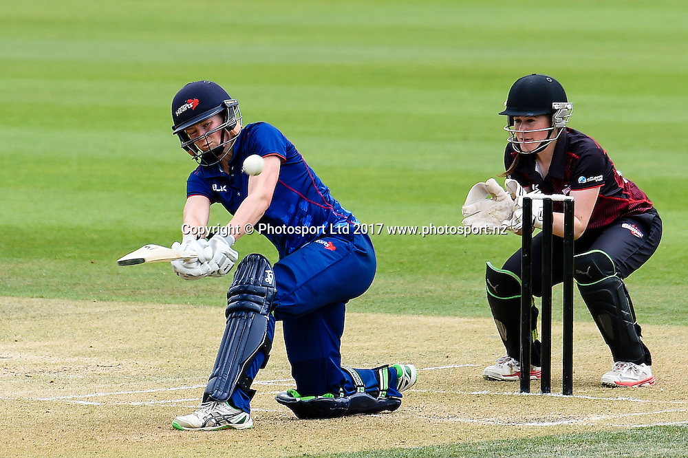 Maddy Green of the Auckland Hearts sweeps the ball with Jacinta Savage of the Canterbury Magicians looking on during the Womens Domestic One Day Final cricket game, Canterbury V Auckland, Hagley Oval,Christchurch, New Zealand, 12th February 2017.Copyright photo: John Davidson / www.photosport.nz