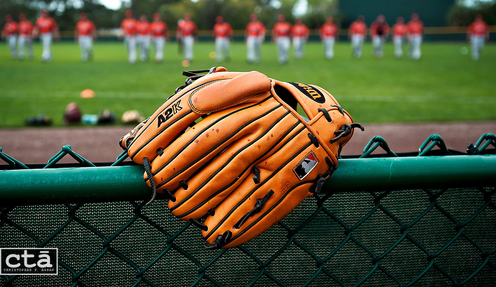 A light rain falls as the Orioles pitchers and catchers stretch and warm up for the second day of workouts in Sarasota, Fla.