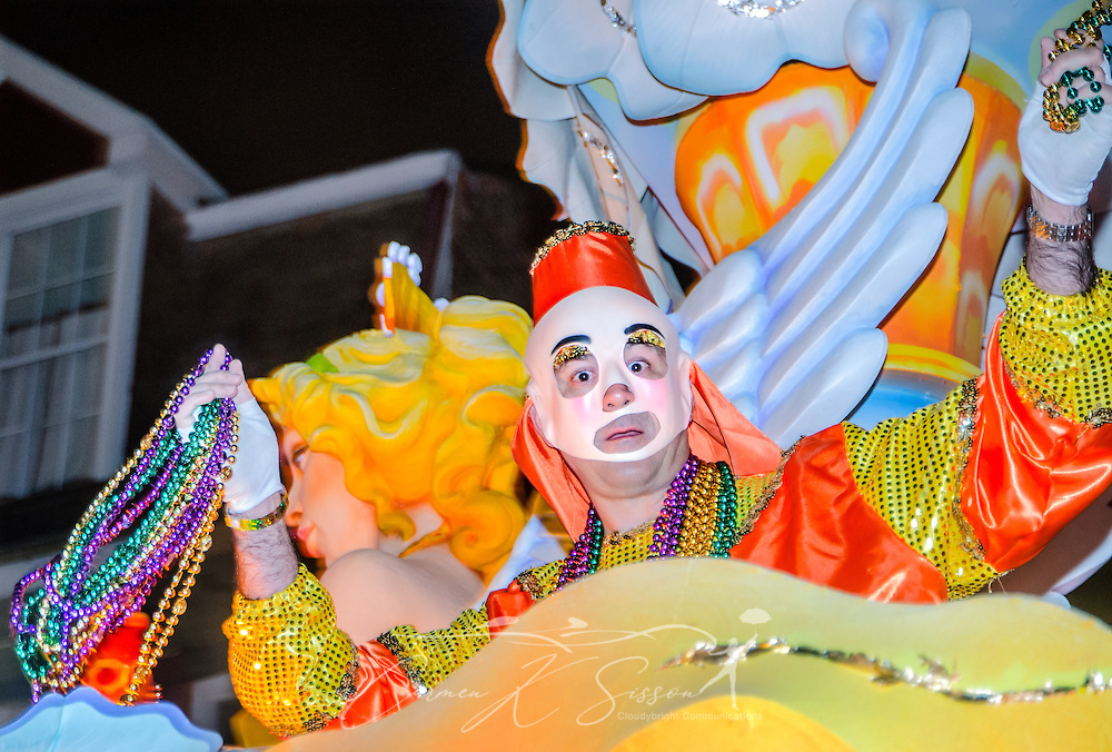 A member of the Krewe of Hermes throws beads as his float rolls down St. Charles Avenue at the Krewe of Hermes Mardi Gras parade at Lee Circle, Feb. 28, 2014, in New Orleans, Louisiana. (Photo by Carmen K. Sisson/Cloudybright)