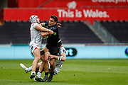 Ospreys centre Kieron Fonotia attempts to break a tackle during the Guinness Pro 12 2017 Round 21 match between Ospreys and Ulster at the Liberty Stadium, Swansea, Wales on 29 April 2017. Photo by Andrew Lewis.