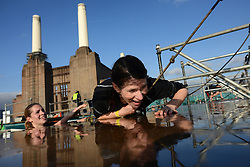 Runners compete during the 10km Men's Health Survival of the Fittest race at Battersea Power Station in London, Saturday, 16th November 2013.   Picture by Peter Kollanyi / i-Images