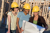 Young women in construction site