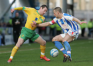 Huddersfield - Saturday, March 13th, 2010: Peter Clarke of Huddersfield Town in action against Stephen Elliott of Norwich City during the Coca Cola League One match at the Galpharm Stadium, Huddersfield. (Pic by Michael Sedgwick/Focus Images)