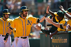 OAKLAND, CA - SEPTEMBER 22: Josh Reddick #16 of the Oakland Athletics celebrates with teammates after scoring a run against the Minnesota Twins during the second inning at O.co Coliseum on September 22, 2013 in Oakland, California. The Oakland Athletics defeated the Minnesota Twins 11-7 as they clinched the American League West Division. (Photo by Jason O. Watson/Getty Images) *** Local Caption *** Josh Reddick