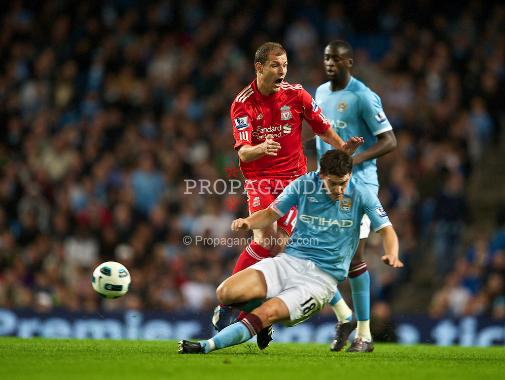 MANCHESTER, ENGLAND - Monday, August 23, 2010: Liverpool's Milan Jovanovic is tackled by Manchester City's Gareth Barry during the Premiership match at the City of Manchester Stadium. (Photo by David Rawcliffe/Propaganda)