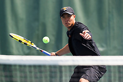 May 24, 2011; Stanford, CA, USA;  Southern California number 3 singles player Daniel Nguyen hits a forehand against Virginia Cavaliers number 3 singles player Sanam Singh (not pictured) during the finals of the men's team 2011 NCAA Tennis Championships at the Taube Tennis Center. USC defeated UVA 4-3.