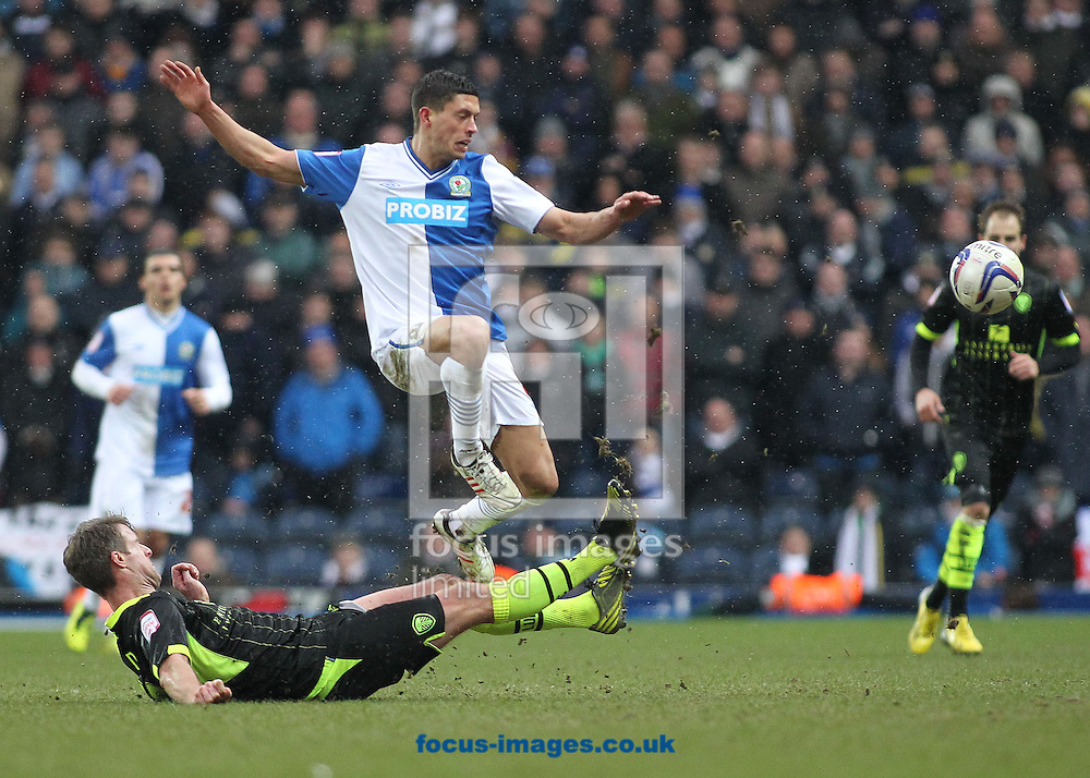 Picture by Michael Sedgwick/Focus Images Ltd +44 7900 363072.23/02/2013.Jason Lowe of Blackburn Rovers is tackled by Michael Tonge of Leeds United during the npower Championship match at Ewood Park, Blackburn.