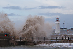 © Licensed to London News Pictures. 03/01/2014.New Brighton, UK . Waves hit New Brighton promenade as the high tide arrives. Photo credit : Andrew Dawson/LNP