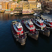 Tug boats docked near water front restaurants along the  Piscataqua River in Portsmouth, NH.