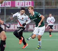AMSTELVEEN - Tanguy Cosyns (Adam) met Justen Blok (Rdam) tijdens  de hoofdklasse hockeywedstrijd Amsterdam-HC Rotterdam (7-1).    COPYRIGHT KOEN SUYK