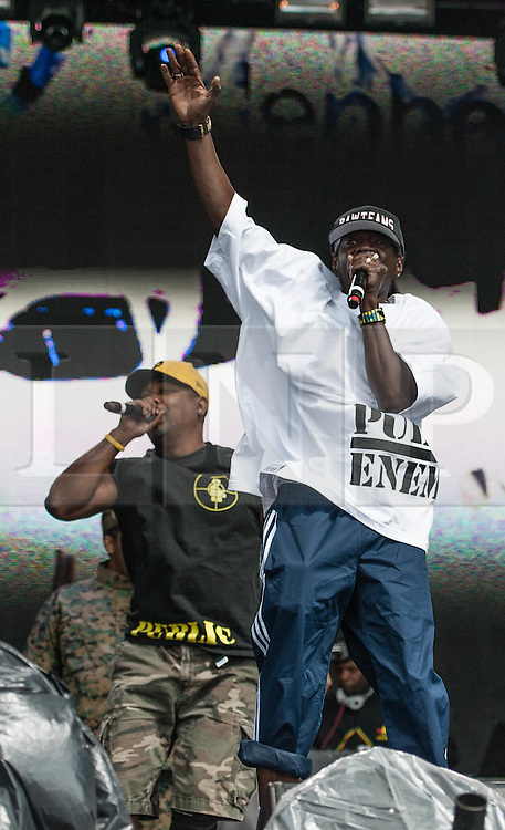 © Licensed to London News Pictures. 26/08/2012.  London, UK.  Chuck D (L) and Flavour Flav ® of Public Enemy live at South West Four/SW4 on Clapham Common during the August Bank Holiday Weekend.  Photo credit : Richard Isaac/LNP