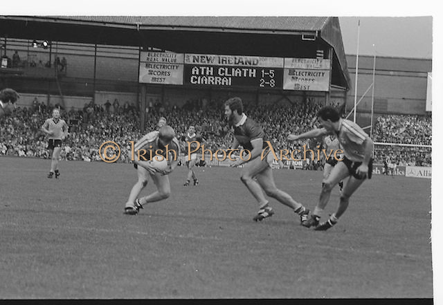 Dublin player protects the ball from oncoming Kerry player during the All Ireland Senior Gaelic Football Championship Final Kerry v Dublin at Croke Park on the 22nd September 1985. Kerry 2-12 Dublin 2-08.