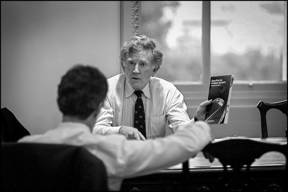 """Former Sen. Gary Hart briefs Sen. Dashle and other Senators during a meeting on terrorism.  He's holding the book """"Road Map to National Security"""" 9/24/01..©PF BENTLEY/PFPIX.com"""