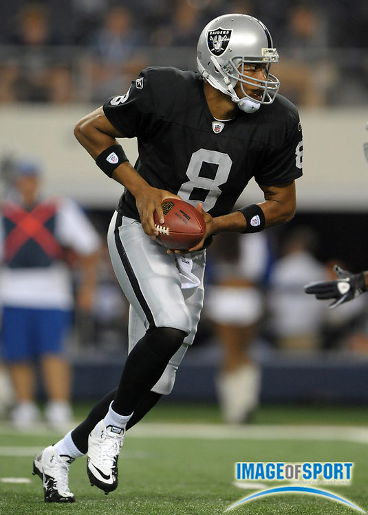 Aug 12, 2010; Arlington, TX, USA; Oakland Raiders quarterback Jason Campbell (8) during the game against the Dallas Cowboys at Cowboys Stadium. Photo by Image of Sport