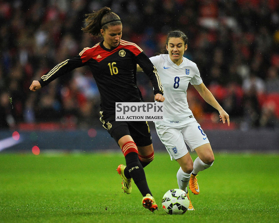 Germanys Melanie Leupolz Holds of Englands Karen Carney, England v Germany Ladies, Breast Cancer Care International, Wembley , Sunday 23rd November 2014