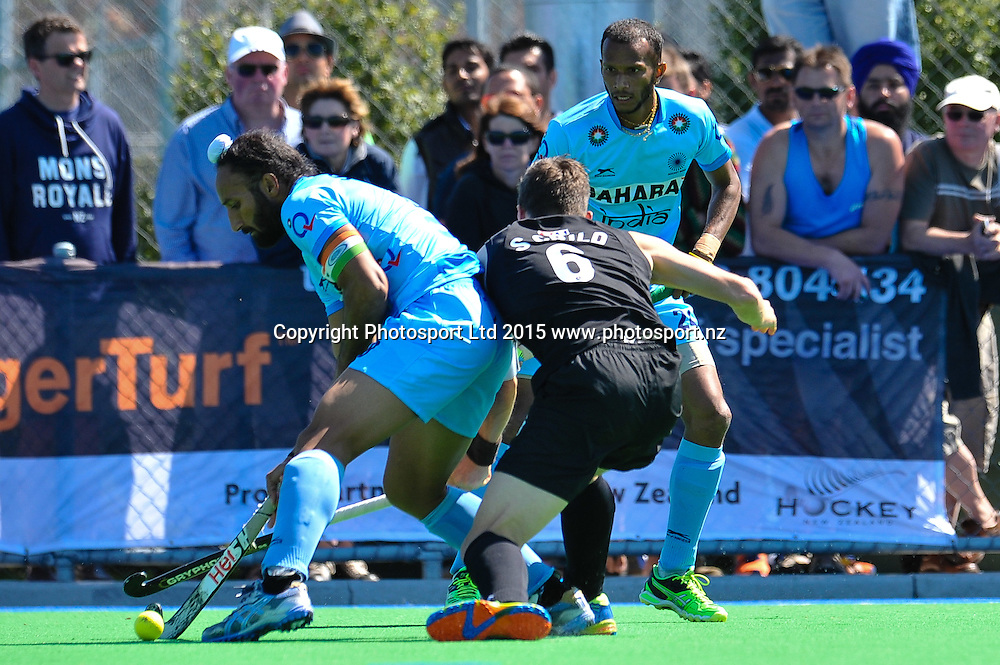 Sardar Singh of India eludes Simon CHILD of the Black Sticks during the Mens Hockey International, 2015 South Island Tour game between the New Zealand Black Sticks V India, at Marist Park, Christchurch, on the 11th October 2015. Copyright Photo: John Davidson / www.photosport.nz
