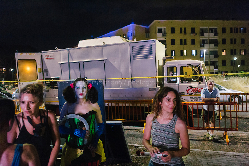 ROME, ITALY - 27 JUNE 2017: Opera singer Reut Ventorero (center-left, in the role of Zerlina) and costume assistant Francesca Ghermandi (center-right) are seen here in the backstage of &quot;Don Giovanni OperaCamion&quot;, an open-air opera performed on a truck in San Basilio, a suburb in Rome, Italy, on June 27th 2017.<br /> <br /> Director Fabio Cherstich&rsquo;s idae of an &ldquo;opera truck&rdquo; was conceived as a way of bringing the musical theatre to a new, mixed, non elitist public, and have it perceived as a moment of cultural sharing, intelligent entertainment and no longer as an inaccessible and costly event. The truck becomes a stage that goes from square to square with its orchestra and its company of singers in Rome. <br /> <br /> &ldquo;Don Giovanni Opera Camion&rdquo;, after &ldquo;Don Giovanni&rdquo; by Wolfgang Amadeus Mozart is a new production by the Teatro dell&rsquo;Opera di Roma, conceived and directed by Fabio Cherstich. Set, videos and costumes by Gianluigi Toccafondo. The Youth Orchestra of the Teatro dell&rsquo;Opera di Roma is conducted by Carlo Donadio.