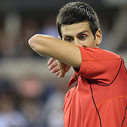 Novak Djokovic, Serbia,  in action against Rafael Nadal, Spain, during the Men's Singles Final at the US Open, Flushing. New York, USA. 9th September 2013. Photo Tim Clayton