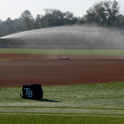 February 20, 2011; Port Charlotte, FL, USA; A grounds keeper prepares the field prior to a spring training practice at Charlotte Sports Park.  Mandatory Credit: Derick E. Hingle