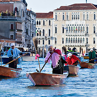 VENICE, ITALY - JANUARY 06:  Participants raw on the Grand Canal during the 34th Befana Regata on January 6, 2012 in Venice, Italy.  In Italian folklore, Befana is an old woman who delivers gifts to children throughout Italy on the feast of the Epiphany on January 6 in a similar way to Saint Nicholas or Santa Claus.