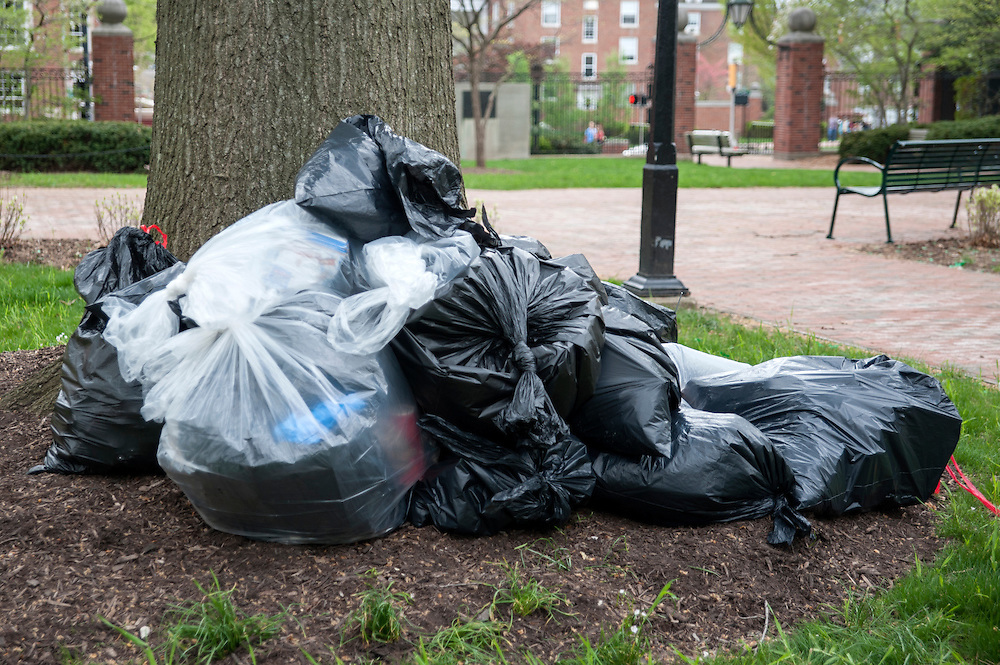 Trashbags are gathered in a pile on College Green as students finish their service and Athens Beautification Day comes to a close on Sunday, April 19.