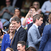 LONDON, ENGLAND - JULY 16: Anna Eberstein, Hannah Bagshawe and Hugh Grant, Eddie Redmayne and Bradley Cooper at the Mens Singles Final between Roger Federer of Switzerland and Marin Cilic of Croatia during the Wimbledon Lawn Tennis Championships at the All England Lawn Tennis and Croquet Club at Wimbledon on July 16, 2017 in London, England. (Photo by Tim Clayton/Corbis via Getty Images)