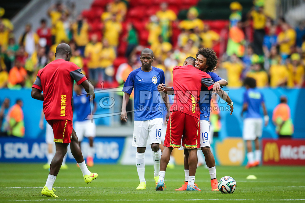 BRASILIA, BRAZIL - June 23, 2014:  Brazil kicks the ball during the 2014 World Cup Group A game between Brazil and Cameroon at Estadio Nacional Mane Garrincha. No Use in Brazil.
