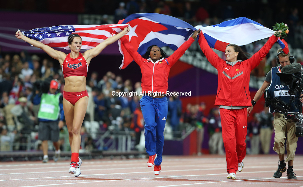 06.08.2012. London, England. Gold medalist Jennifer Suhr of USA l Silver medalist Yarisley Silva of Cuba C and Bronze medalist Elena Isinbaeva of Russia Celebrate After Women s Pole Vault Final Contest London 2012 Olympic Games