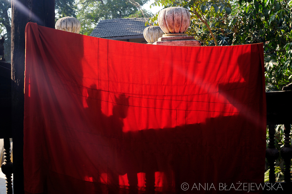 Burma/Myanmar, Mandalay. Monk's robe drying in the sun in teak monastery called Shwe In Bin Kyanung.