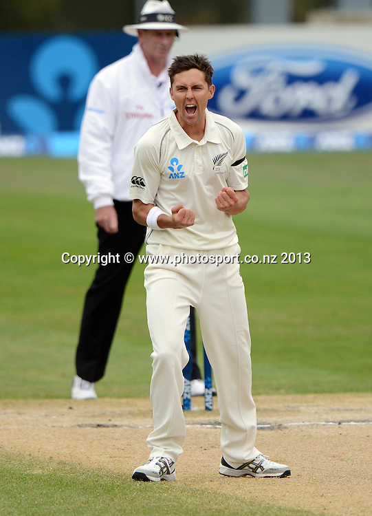 Trent Boult celebrates the wicket of Darren Bravo on Day 5 of the 1st cricket test match of the ANZ Test Series. New Zealand Black Caps v West Indies at University Oval in Dunedin. Saturday 7 December 2013. Photo: Andrew Cornaga/www.Photosport.co.nz