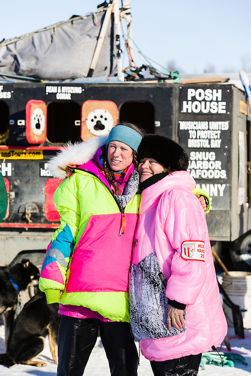 Monica Zappa and handler pose for a photo before the restart of the 42nd Iditarod Trail Sled Dog Race on Willow Lake in Southcentral Alaska.  Afternoon. Winter.