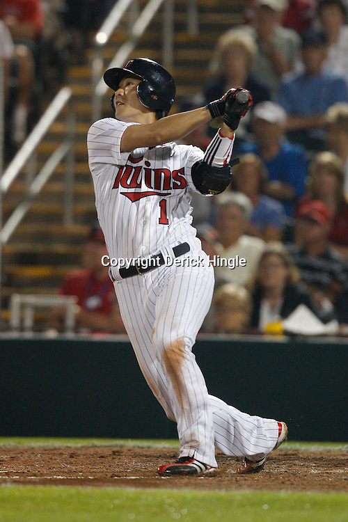 February 27, 2011; Fort Myers, FL, USA; Minnesota Twins second baseman Tsuyoshi Nishioka (1) singles during a spring training exhibition game against the Boston Red Sox at Hammond Stadium.  Mandatory Credit: Derick E. Hingle
