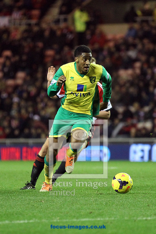 Picture by Paul Chesterton/Focus Images Ltd +44 7904 640267<br /> 21/12/2013<br /> Leroy Fer of Norwich and Sunderland's Lee Cattermole in action during the Barclays Premier League match at the Stadium Of Light, Sunderland.