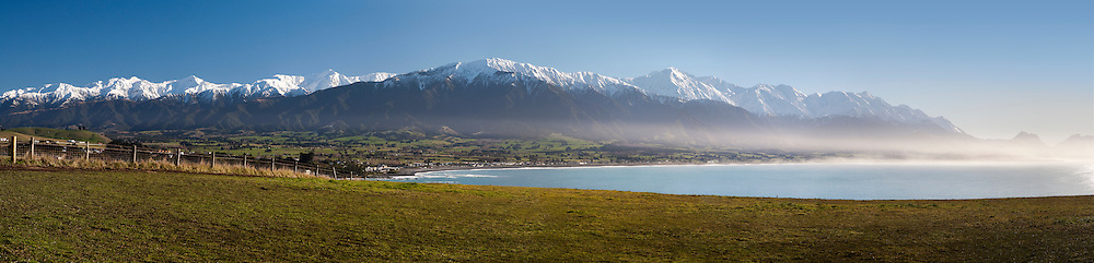 magnificent panoramic of a sea mist spreading over kaikoura and its mountain range backdrop, kaikoura, new zealand