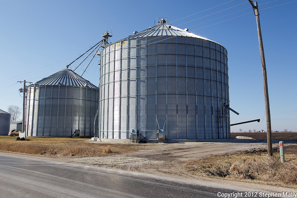 A 100,000 (from left) and 200,000 bushel grain bin on the farm of Rick Elliott in Monmouth, Illinois on Friday, February 17, 2012. .